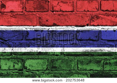 The Gambia flag painted on the brick wall