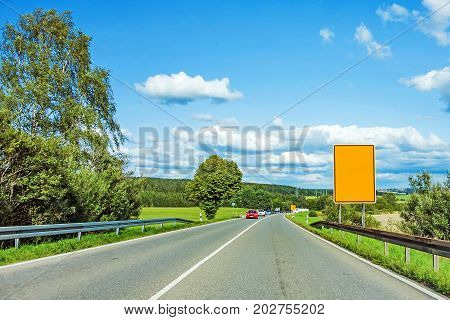 Through Road With Yellow Road Sign