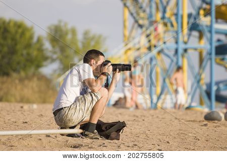 The picture on which the photographer on the beach, for photostocks