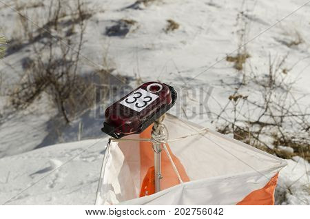 Orienteering control point in a snow field
