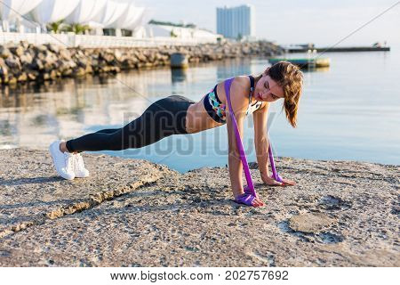 Woman Working Out On The Beach