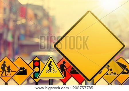 Empty Yellow And Set Of Traffic Sign On Blur Traffic Road With Colorful Bokeh City Light Abstract Ba