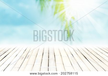 Blur Tropical Beach With Bokeh Sun Light Wave And Palm Tree On Empty Old Wood Table Abstract Backgro