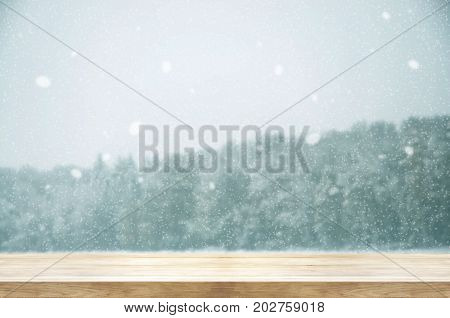 Christmas And New Year Background. Wooden Table With Winter Snowfall Covered Forest. Vintage Color T