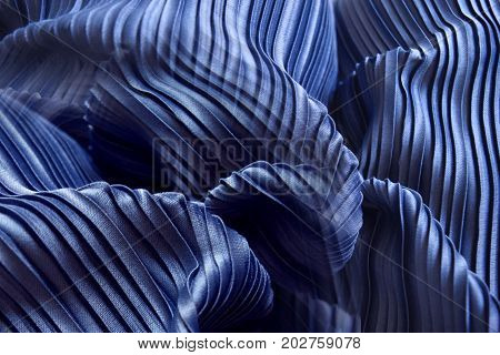Blue pleat fabric background is a beautiful curved wave.