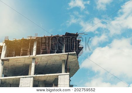 Copy Space Of Incomplete Building Construction Site On Blue Sky Background. Building And Business In