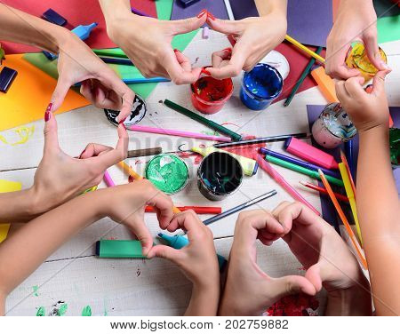 Artists Hands With Stationery And Colored Paper. Messy Art Concept