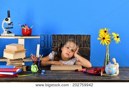 Schoolgirl With Colorful Stationery, Books, Globe, Clock And Flowers