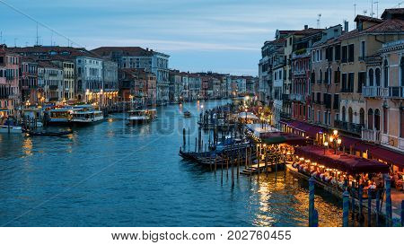 Grand Canal at night in Venice, Italy. Grand Canal is one of the major water-traffic corridors and tourist attraction in Venice. 16:9 widescreen.