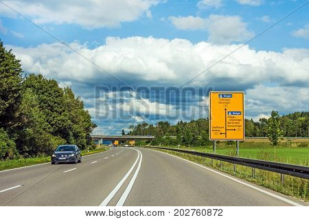 Road Sign On Through Road With Car