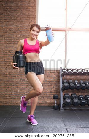 sport woman with whey protein in the gym