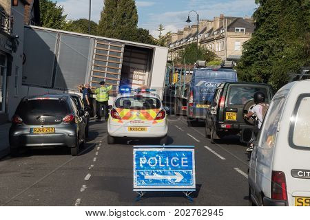 BATH UK - 01 SEP 2017 Lorry stuck on steep hill with driver and police and sign. HGV unable to move after attempting a sharp turn off London Road causing police response and traffic chaos