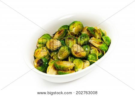 Brussels Sprouts Cabbage With Lemon Isolated on White background. Selective focus.