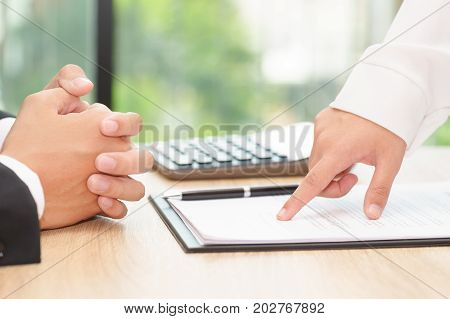 Businesswoman pointing a place where should sign the employment agreement
