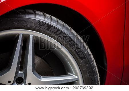 BANGKOK, THAILAND - AUGUST, 30 2017: Michelin tire installed in red Mercedes Benz CLA 250 2017 model