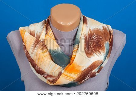 Beige Scarf On Mannequin Isolated On Blue Background.