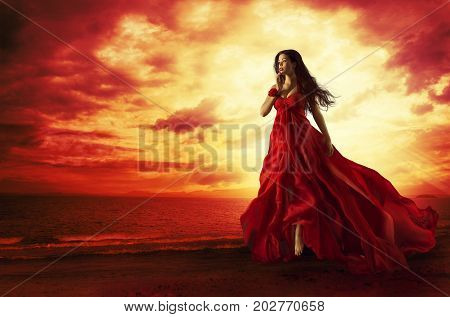 Woman Flying Red Dress Fashion Model in Evening Gown Levitating Outdoors Sunset