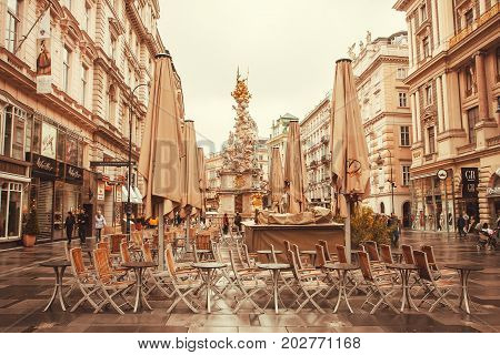 VIENNA, AUSTRIA - JUN 10, 2016: Rainy weather and umbrellas of city cafe in historical area of austrian capital on June 10, 2016. Vienna has population near 1.8 million