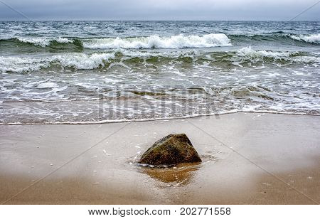 seashore in a storm on gloomy summer day