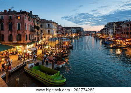 Venice, Italy - May 17, 2017: Grand Canal at night. Grand Canal is one of the major water-traffic corridors and tourist attraction in Venice.