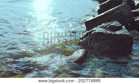 Waves of ocean waves beat against stones. Strong storm sea ocean