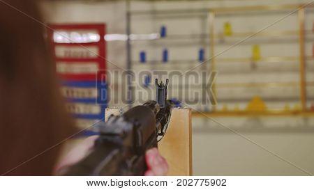 Boy teen shoots in dash from the machine gun. Airguns gun. boy gun lifestyle