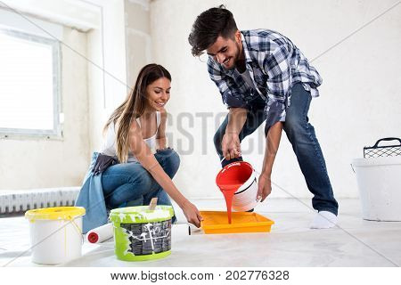Lovely Smiling Couple Painting New Home,new House Renovation