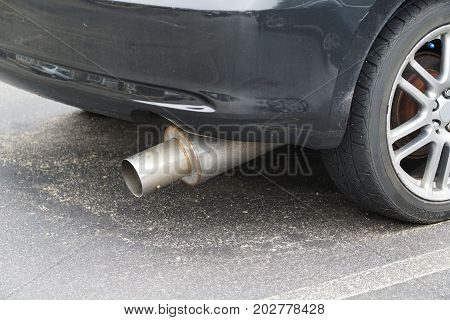 close up on modified exhaust muffler of the vehicle