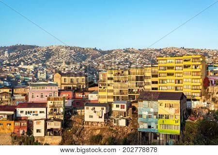 Golden light falling on the colorful hills of Valparaiso Chile