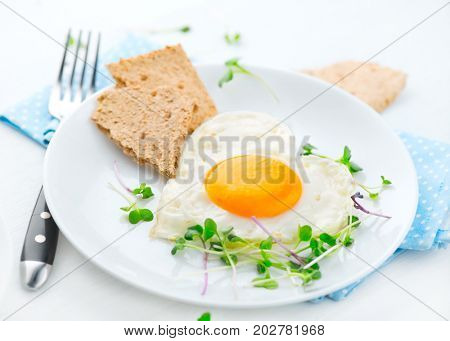 Healthy breakfast Fried heart shaped egg close up. Diet, dieting concept. Healthy low calories food. Weight loss