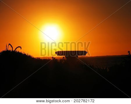 A SILHOUETTE IN THE FORE GROUND, WITH A GOLDEN RED SUN SET IN THE BACK GROUND