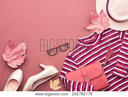 Autumn Arrives. Fashion Lady Clothes Set. Trendy Knit Jumper, Hat. Fashion Stylish Handbag Clutch, Glamour Shoes, Glasses. Fall Leaves. Vanilla Pastel colors.