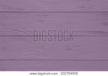 Purple painted wood board texture and background. Purple natural wooden background. Aged wood planks pattern. Wooden surface. Horizontal timber texture. Purple wood barn. Purple color wood barn. Wood board background. Purple wooden barn background. Painte