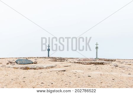 CAPE CROSS NAMIBIA - JUNE 29 2017: The two crosses and memorial stones at the Cape Cross seal colony on the Skeleton Coast of Namibia