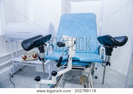 Gynecological Surgery Room With Chair And Equipment. Medical And Healthcare Concept. Selective Focus