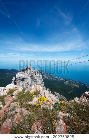 View of Yalta city pine woods Ayu-Dag mountain and Black sea from the top of Ai-Petri plato Crimea Yalta region