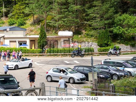 ALSACE FRANCE - JUL 16 2017: Heliport sign on asphalt in crowded parking with people commuting on warm summer day