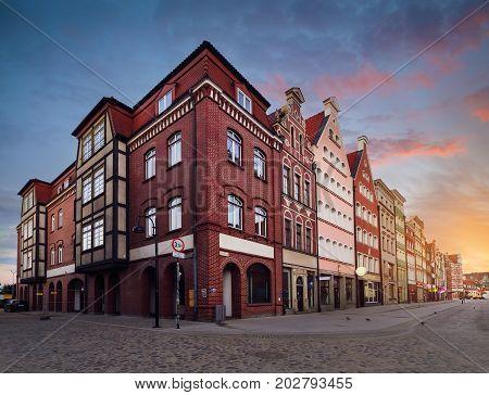 The houses on the street of old city in Gdansk in the evening Poland