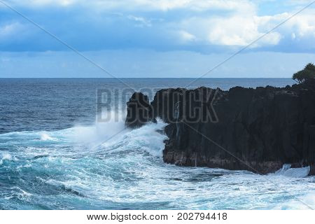 Swell Rolling Over Volcanic Rocks At Reunion Island