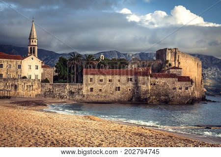 European landmark sea fort with medieval architecture at sunset beach in Europe country Montenegro of Balkan peninsula