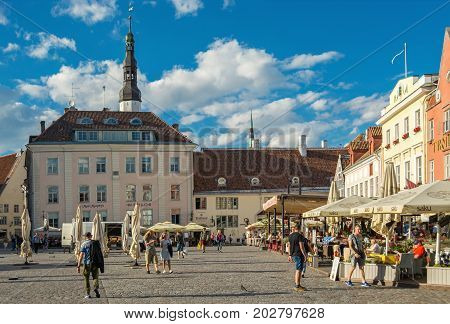 TALLINN ESTONIA August 09: the Townspeople and the tourists have lunch in the cafe and just walk around the town hall square in the old town of Tallinn 09 Aug 2017.