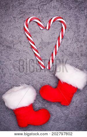Christmas greeting card. Noel festive background. New year symbol. Santas shoes.