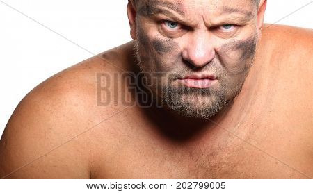 Face of an angry, aggressive, bearded man on a white background.