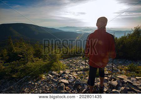 Traveler Admiring Sunset In Mountains