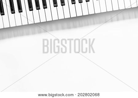 synthesizer in music studio for dj or musician work on white desk background top view mock-up