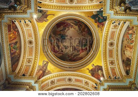 SAINT PETERSBURG RUSSIA - AUGUST 15 2017. Icons and decorated dome with Bible scenes in the interior of the St Isaac Cathedral in Saint Petersburg Russia. Saint Petersburg Russia landmark