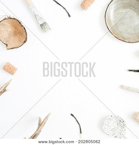 Layout with copy space made of goat horns handmade plate coconut tools for handmade arts on white background. Top view flat lay hipster artist concept.