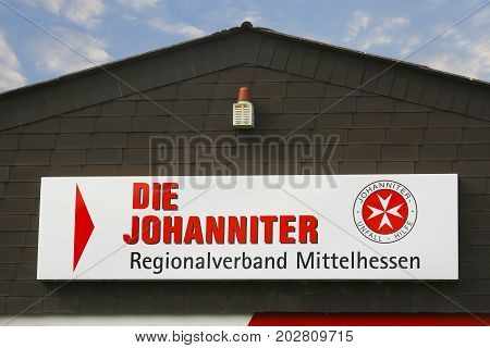 LINDEN GERMANY JULY 2017: DIE JOHANNITER Logo on a house facade. JOHANNITER is a emergency service accident aid in Germany based in Berlin Germany.