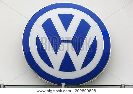 HUETTENBERG GERMANY JULY 2017: Volkswagen VW plate logo on a house facade. Volkswagen is a famous European car manufacturer company based on Wolfsburg in Germany.