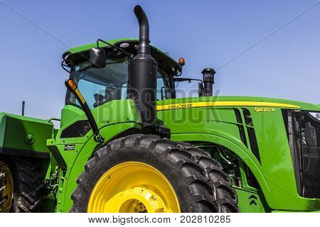 Indianapolis - Circa August 2017: 9430R Tractor at a John Deere Dealership. Deere manufactures agricultural construction and forestry machinery VIII